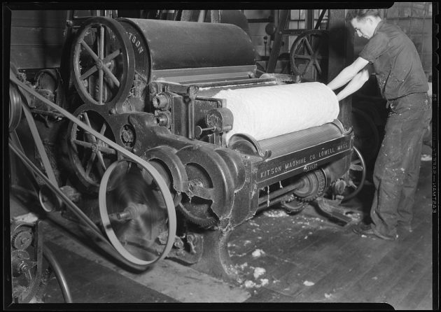 1024px-Millville,_New_Jersey_-_Textiles._Millville_Manufacturing_Co._(Man_rolling_fabric.)_-_NARA_-_518685