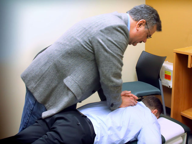 1200px-Chiropractic_spinal_adjustment
